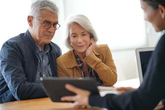 Older couple purchasing remodeling services from DreamMaker Bath & Kitchen