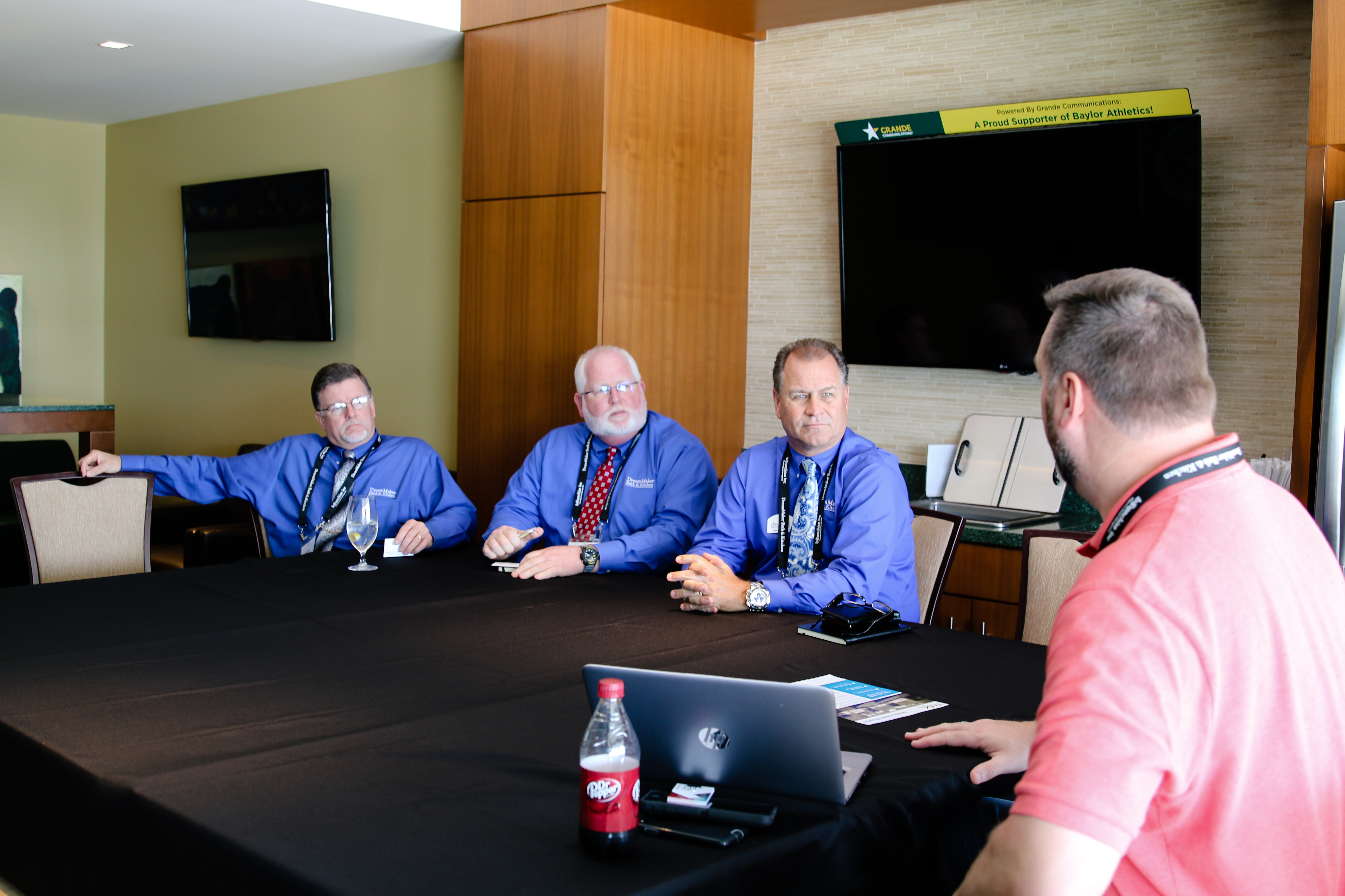 DreamMaker Franchisees sitting at round table with national vendor partner learning new systems