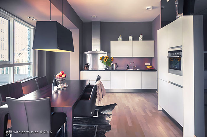 A contemporary kitchen design with white cabinets, a dark wood table, black-shaded overhead light and a hardwood floor.