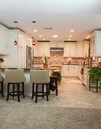 This remodel from DreamMaker of Bakersfield demonstrates one of the biggest trends in kitchen remodeling — opening the kitchen up to the rest of the living space.