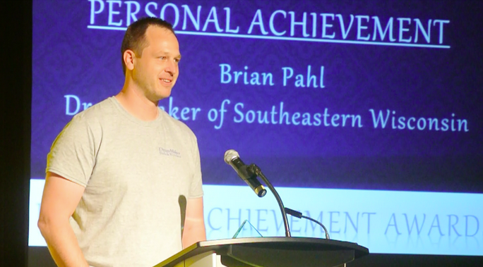 DreamMaker franchise owner Brian Pahl receives an award for personal achievement during the 2014 DreamMaker Reunion in Branson, Missouri.