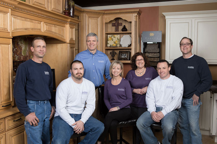 Curt, standing second from left, and Debbie Trampe, center, with their team at DreamMaker Bath & Kitchen of Springfield.