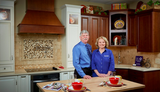 Franchisee Glen Borkowski and his wife, Denise, pose in his kitchen showroom