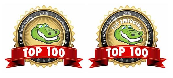 """Two gold medal badges with a smiling alligator logo. The medal on the left reads """"Franchise Gator 