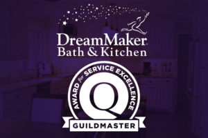 "The phrase ""Award for Service Excellence"" surrounds the GuildQuality ""Q"" logo, with ""Guildmaster"" in a ribbon below."