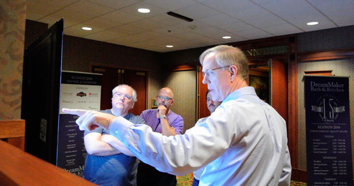 A software developer demonstrates DreamMaker's proprietary software to franchisees at DreamMaker's 2014 reunion in Branson, Missouri.