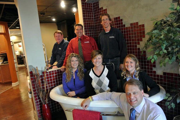 DreamMaker Bath & Kitchen President Doug Dwyer (front), with franchise Mike Fischer (in red) and his staff at DreamMaker Bath & Kitchen of Lansing, Michigan.