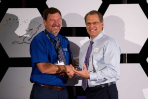 Franchisee of the Year winner Michael Pinkerton, owner of DreamMaker of Colorado Springs, with DreamMaker President and Chief Stewarding Officer Doug Dwyer.