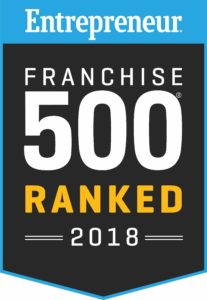"The ""Entrepreneur Franchise 500 Ranked 2018"" logo against a black background with a blue border."