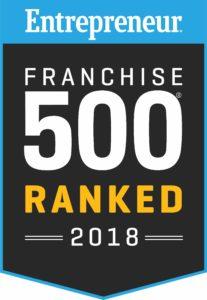 "The ""Entrepreneur Franchise 500 Ranked 2018"" logo against a black background with a blue border."