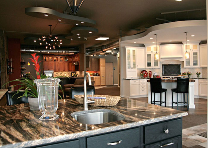 The interior of a DreamMaker Design Center, showcasing a variety of kitchen counters, sinks, tile and cabinetry.