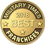 "An image of a gold badge that reads ""Military Times 2018 Best Franchises"""