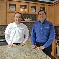 Lee Willwerth and Bob Ender inside their DreamMaker Bath and Kitchen Design Center in Ann Arbor, MI.
