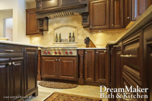 A kitchen remodel is displayed with a dark wood finish on the cabinets and an inset spice rack on the wall by the stove top.
