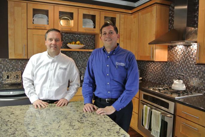 Lee Willwerth and Bob Ender inside their DreamMaker Bath & Kitchen Design Center in Ann Arbor, MI.