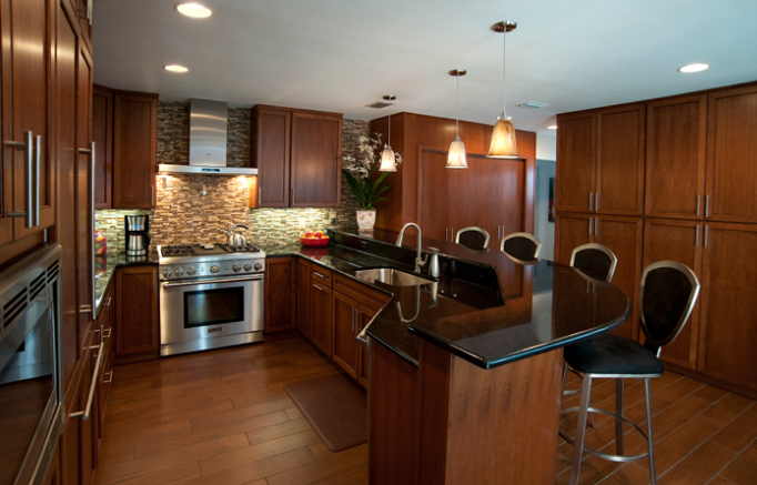 This kitchen remodel by DreamMaker Bath & Kitchen of Manasota makes the room beautiful, and it also makes it a gathering place where friends and family can chat while preparing meals.
