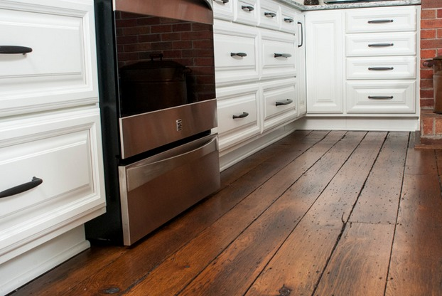 The Valuskas asked DreamMaker Bath & Kitchen of Mansfield, Ohio, to restore the 200-year-old wood floors in the kitchen of their home. It was just one part of a major transformation for the couple's kitchen.