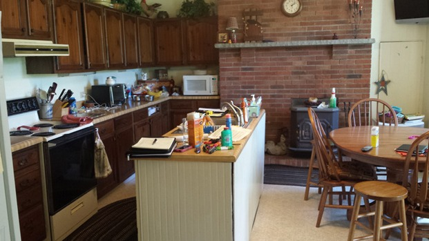 Before the remodel, the kitchen was dark and dated.