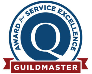 "A badge with the phrase ""Award for Service Excellence"" circling a blue GuildQuality logo and the word ""Guildmaster"" in a red banner at the bottom of the image."